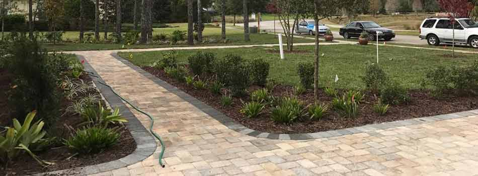 Customers, like this resident in Spring Hill, FL, can opt to have TLB Landscaping design and install custom walkways and other hardscape elements.
