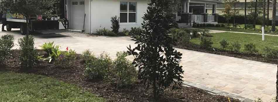 Homeowners like this one in Brooksville, FL benefit from routine lawn mowing and landscape maintenance.
