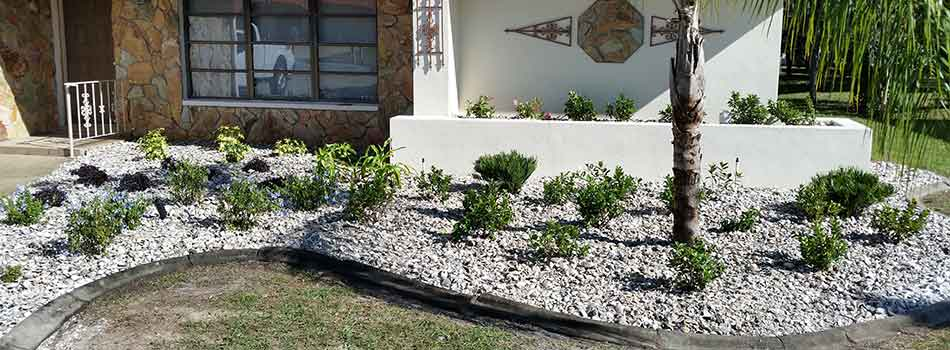 This homeowner in Hernando Beach, FL has opted to have white river rock installed into their landscape bed.