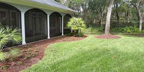 Spring Hill, FL with a routinely mowed lawn by TLB Landscaping.